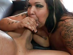 Huge obese tatooed whore gets fuck on a leather couch !