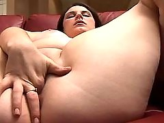 Young brunette BBW masturbates on sofa