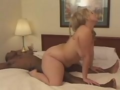 Blond fatty jumps on chocolate cock