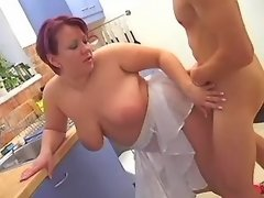 Chubby milf gets facial in kitchen